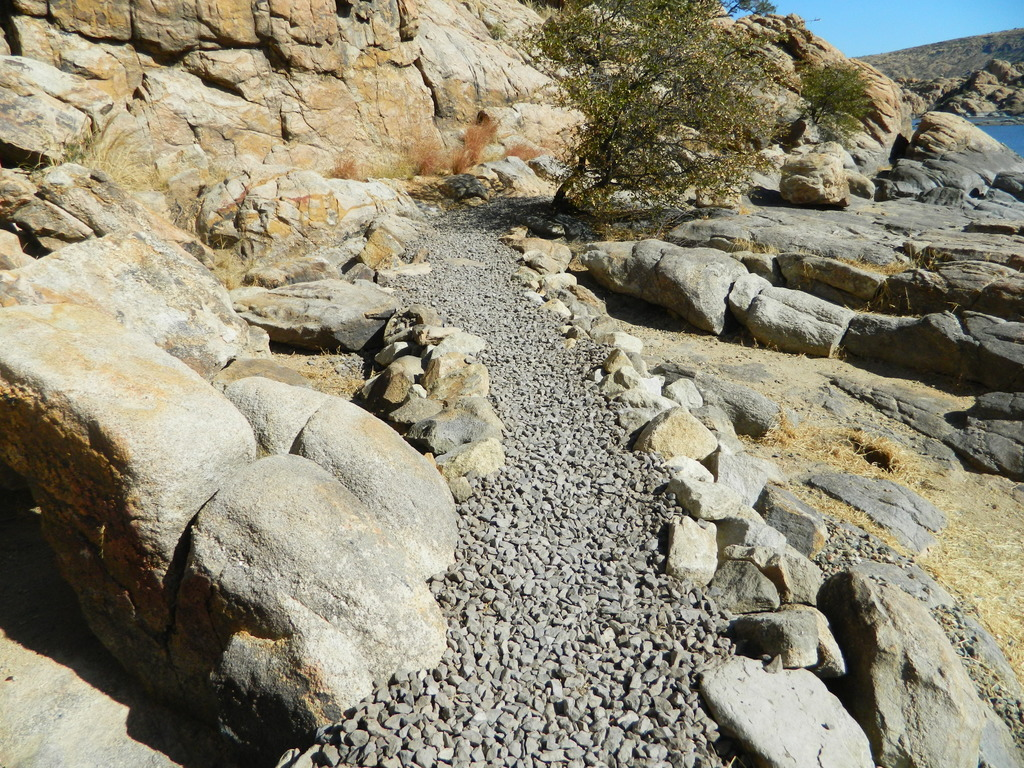 Follow the blue gravel road~