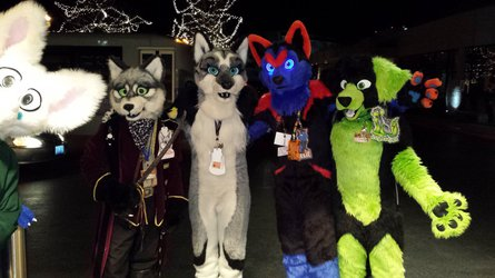 4 suiters of awesomeness with a random fotobomber