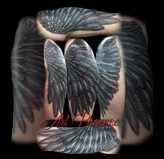 Black Feathered Arm Tattoo