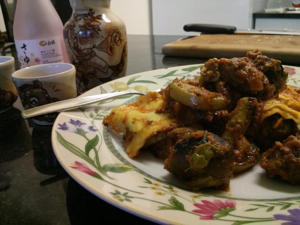 Feta and olive jumbo ravioli with asparagus, zucchini, eggplant, and sausage