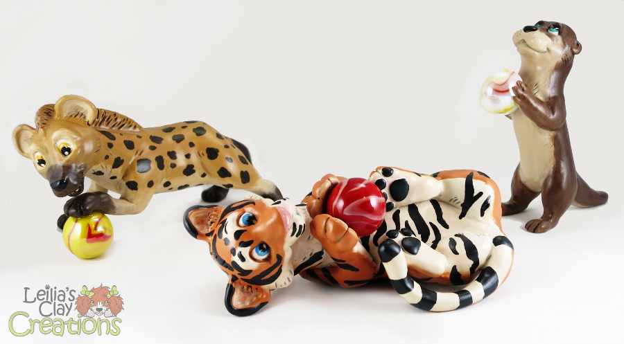 Featured image: Hyena, Tiger and Otter with Marbles
