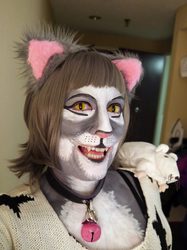 Newsprint with yellow cat eye lenses @ FurFright 2013