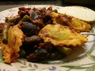 Butternut squash mezzaluna with asparagus, portobello, sundried tomato, eggplant, and smoked apple sage sausage