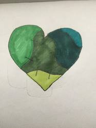 green stitched up heart