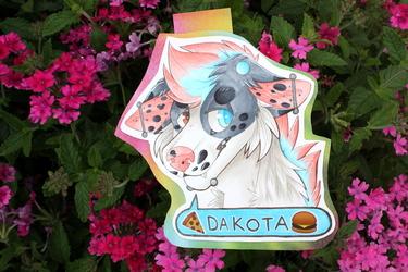 [t] dakota badge