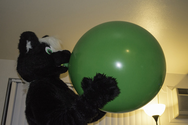 Blowing up a green balloon!