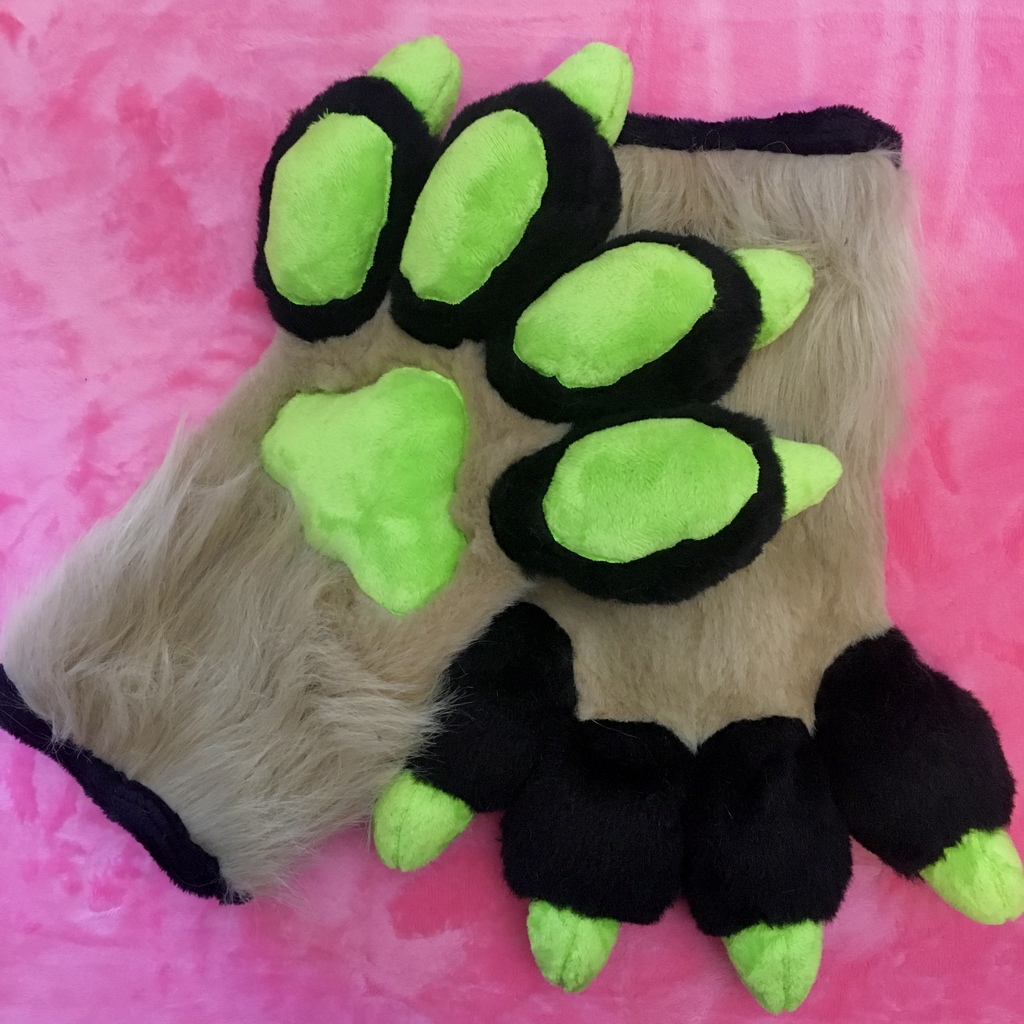 Tan and Black Handpaws With Green Claws Pawpads