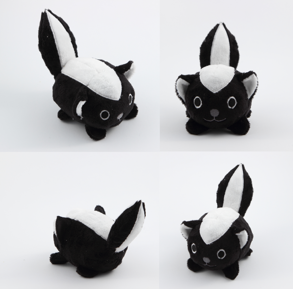 Most recent image: Stinking cute little skunk pebble plushie