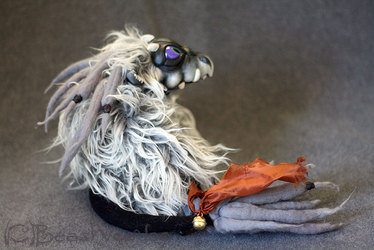 Snow the albino hatchling dragon doll - side view