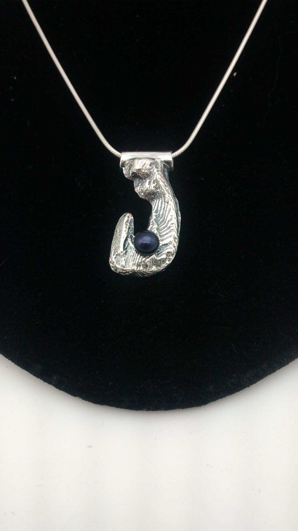 Most recent image: cuttlefish pendant