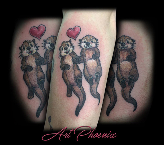 Most recent image: Two Cute Otters Holding Hands Tattoo