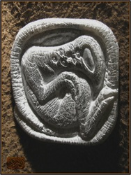 carved stone creature