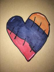 red,blue,yellow stitched up heart
