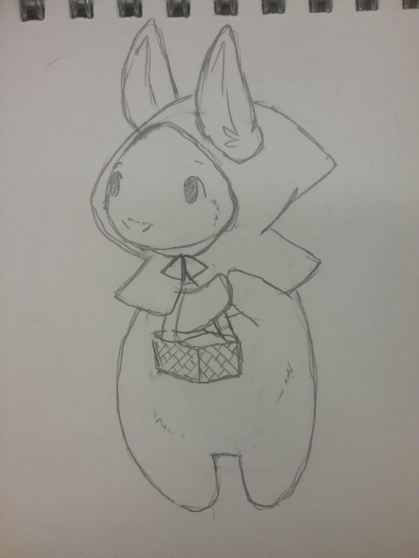 a teeny bun in a teeny hood with a teeny basket