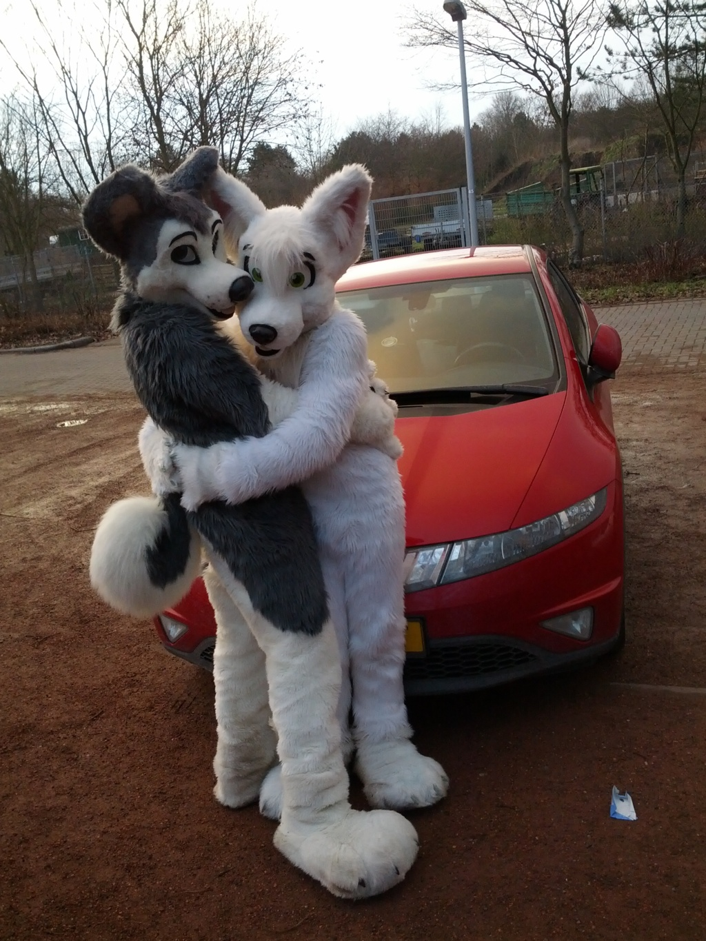 Cuddles in front of a Honda Civic ^-^