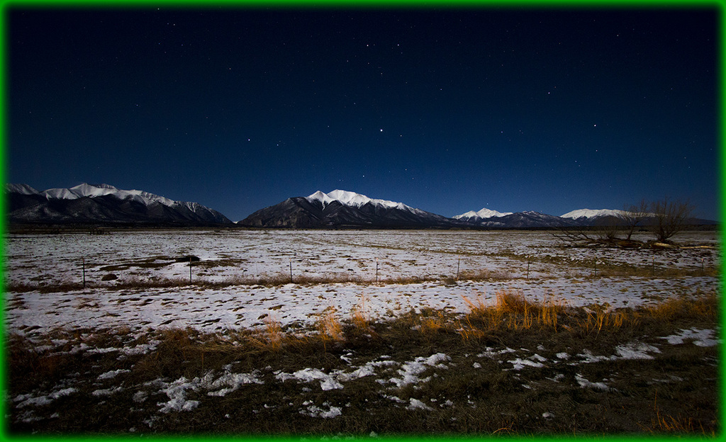 Full Moon lights the snow in Alamosa Valley Colorado