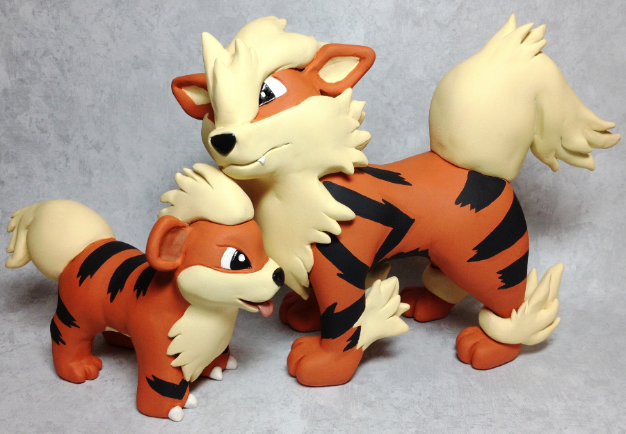 Featured image: Growlithe and Arcanine Sculptures