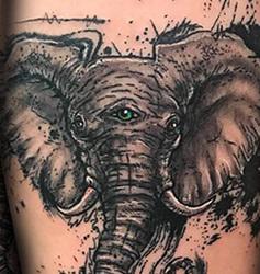 Inky Elephant with 3rd Eye Thigh Tattoo
